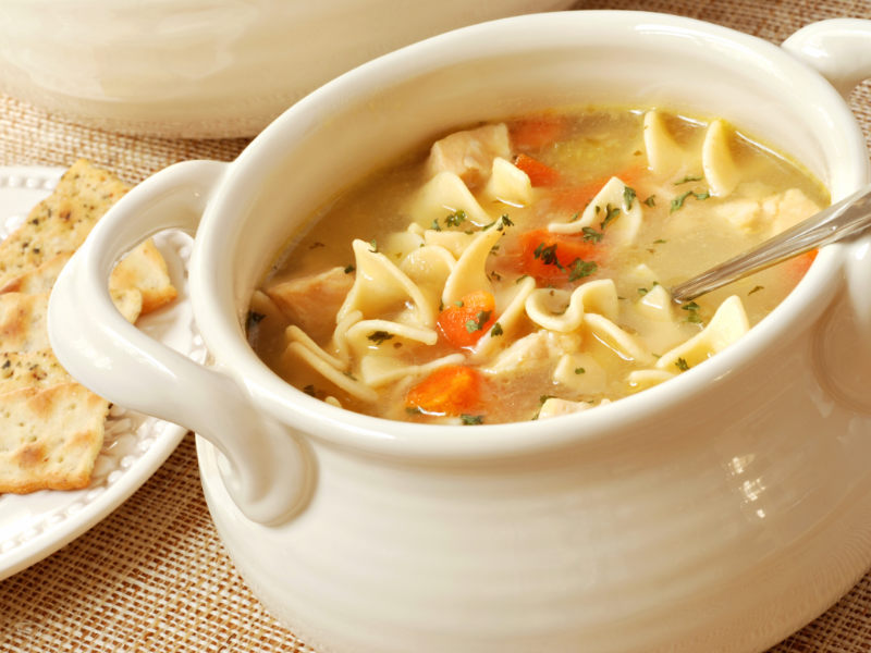 How to Get Rid of the Flu chicken noodle soup with some crackers on the side