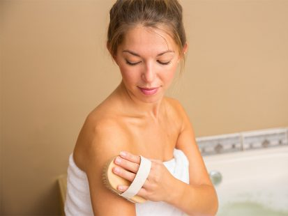 Dry skin in the winter woman exfoliating her skin