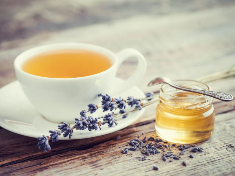 How to Get Rid of the Flu a cup of tea with honey on the side