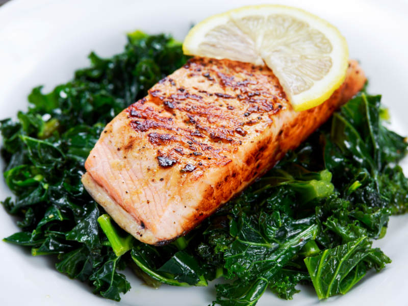 Keto Diet grilled salmon over kale