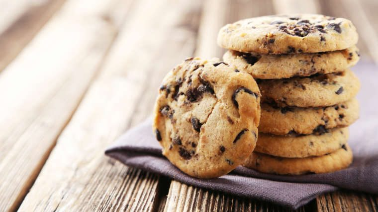 stack of chocolate chip cookies on a wooden board