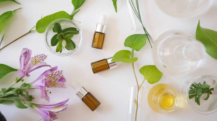 Essential Oil bottles with carrier oils and cream