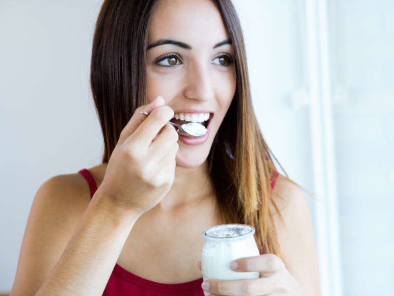 probiotic foods woman eating yogurt