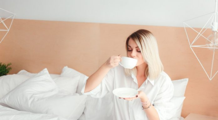 woman sipping bedtime tea in bed