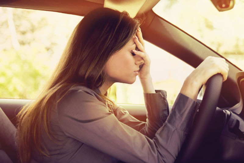 woman stressed out in car