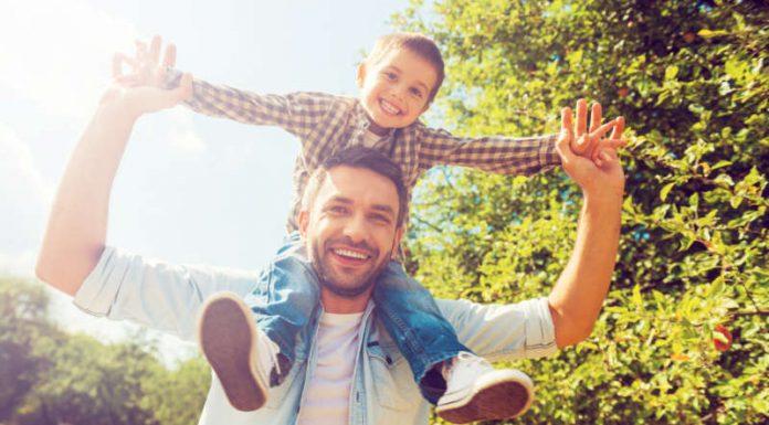 happy man and happy kid outdoors