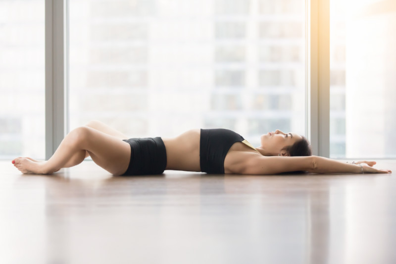 woman in supine butterfly pose
