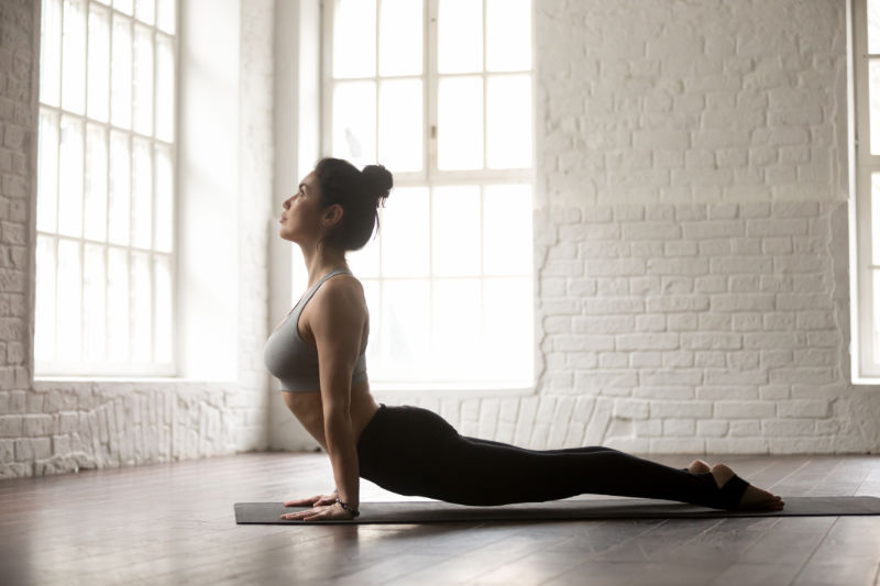 woman in upward-facing dog pose