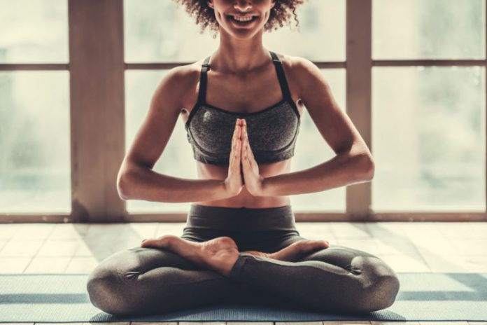 woman practicing yoga for digestion