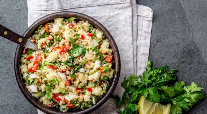 quinoa salad in a bowl with lemon and cilantro