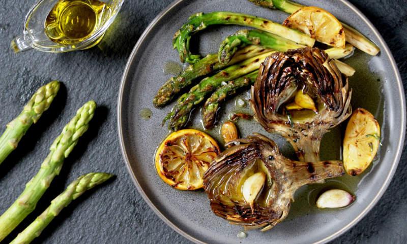 roasted artichoke halves on a plate