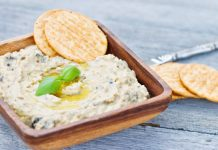 basil parmesan dip in a bowl with crackers