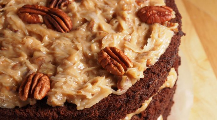 close-up shot of German chocolate cake with coconut pecan frosting