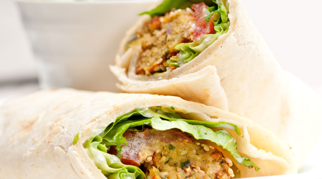 Greek Hummus Wrap with Roasted Red Pepper Hummus_153706610