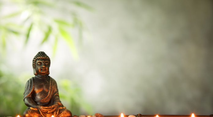 feng shui home with buddha and candles