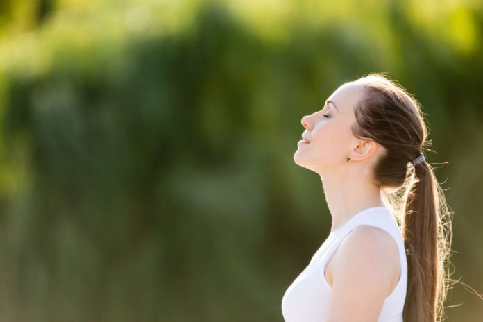 woman finding stress relief in nature