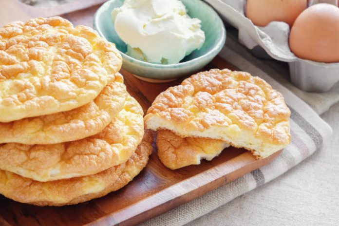 tray full of cloud bread next to eggs and cream cheese