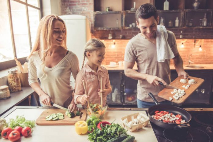 family cooking a healthy meal at home