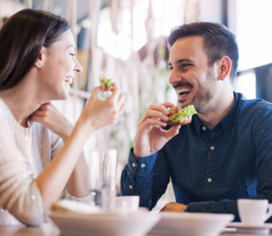 woman and man dining out at a restaurant