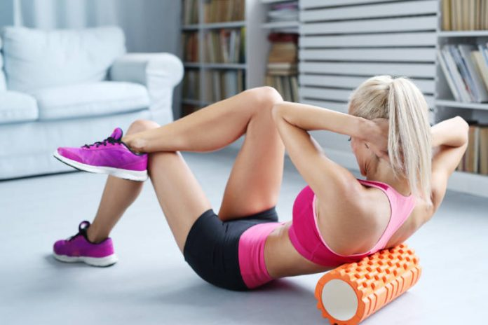 woman doing foam roller exercise