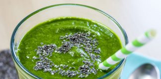 glass of green smoothie with chia seeds on top