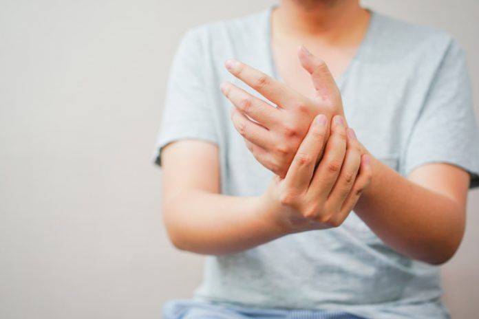man with joint pain in wrist