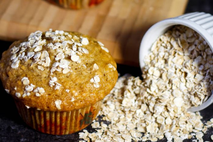 healthy breakfast muffin next to rolled oats