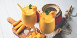 two glasses filled with mango lassi