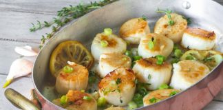 scallops seared in pan with butter, lemon, and herbs