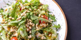 arugula and baby green salad with pine nuts and cherry tomatoes