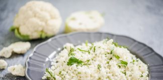 plate with cauliflower couscous and fresh herbs