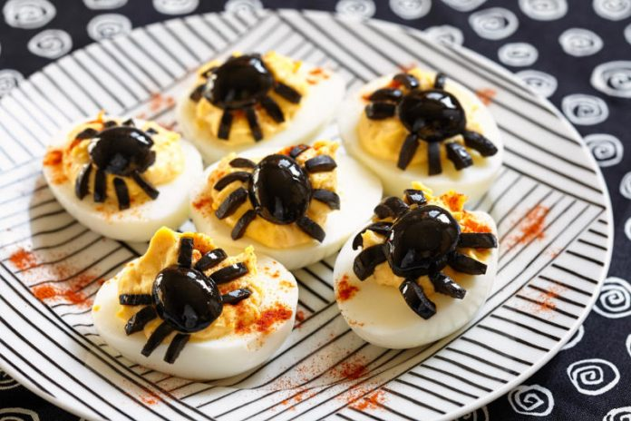 Deviled Eggs with spider olives for halloween