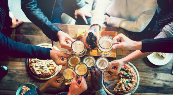 friends clinking beer glasses together