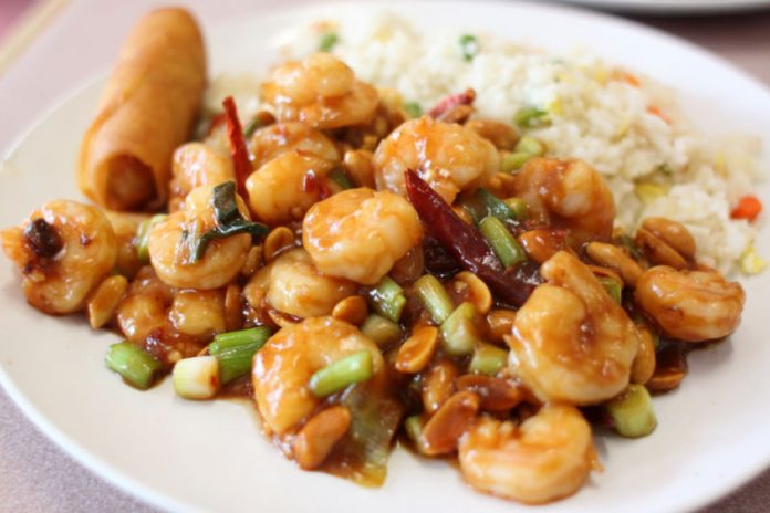 Kung Pao Shrimp on a plate with rice