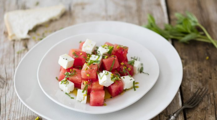 watermelon cubes tossed with feta cheese and fresh mint served on a plate