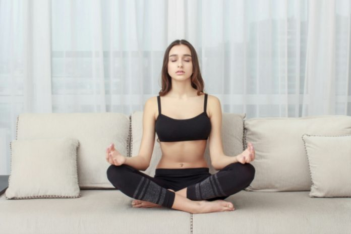 At-Home Series: Yoga Poses to Practice Right On Your Couch