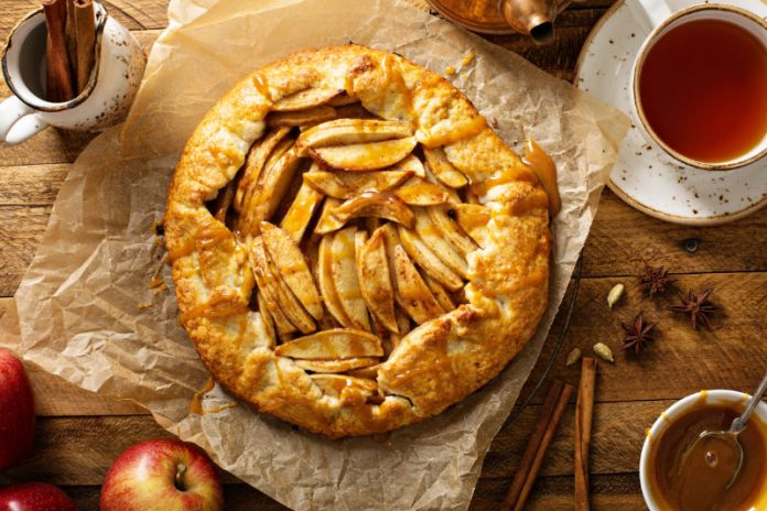apple galette on a sheet of parchment paper