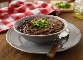 black bean soup in a bowl with fresh cilantro on top
