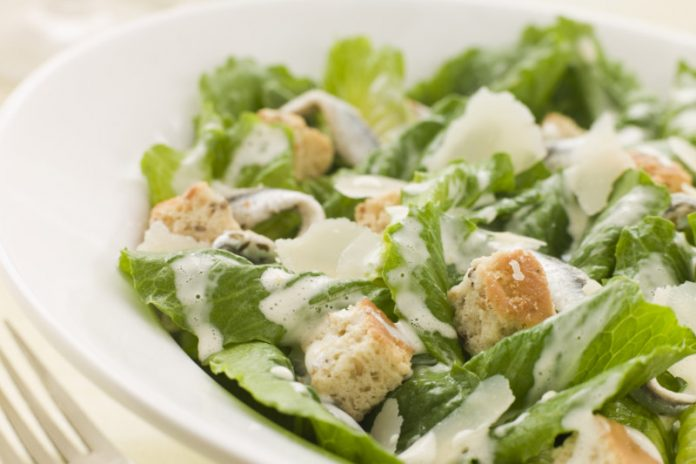 Caesar Salad with Caesar Dressing on top