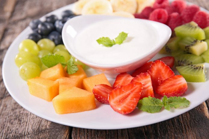 Cream Cheese Dip in a bowl with fresh fruit