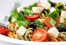 pasta salad with tomatoes, olives, and feta cheese