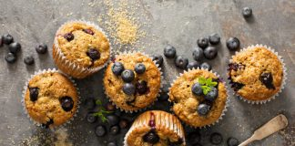 healthy blueberry muffins with sugar topping and fresh blueberries