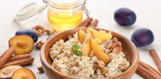 Porridge Recipe with Stewed Fruit on top in a bowl