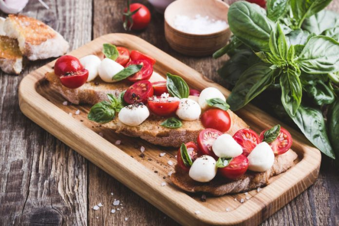 tomato mozzarella salad on toasted bread