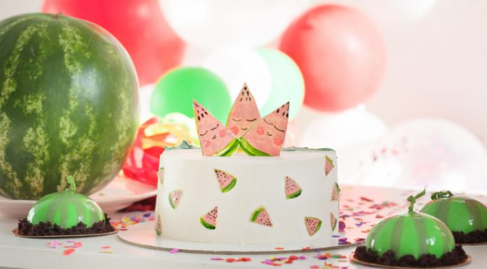 Watermelon Cake frosted on a serving plate