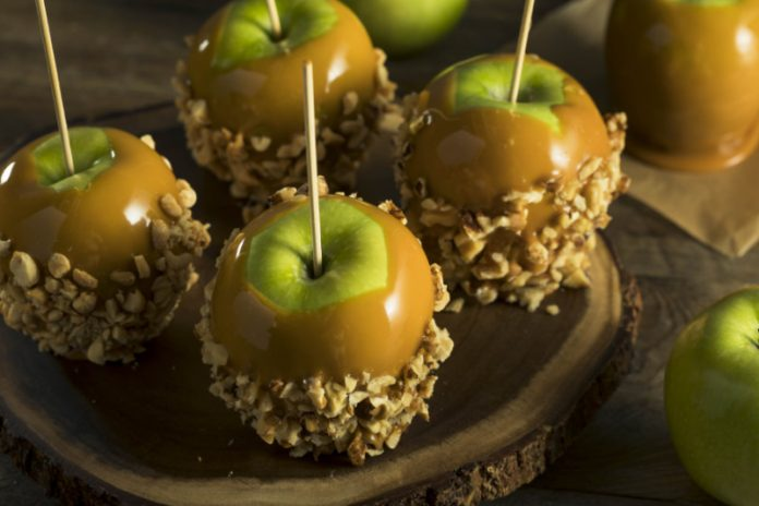 caramel apples with chopped peanuts