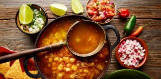 pozole recipe in a bowl with toppings on the side
