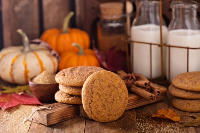 pumpkin snickerdoodle cookies on a wood board