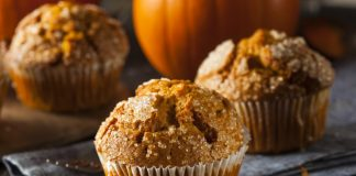 Pumpkin Muffins with autumn leaves on a kitchen towel