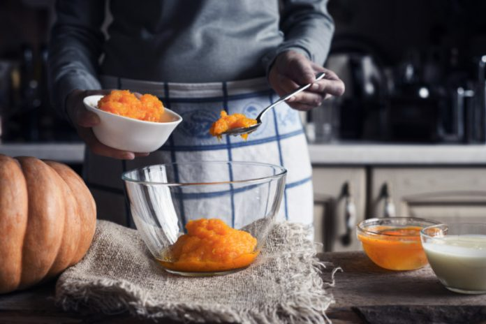 Pumpkin purée being scooped into a bowl